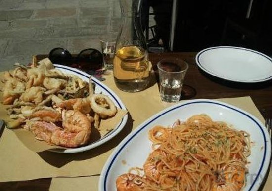 fried seafood mix and big shrimp spaghetti with tomato sauce.+ 1/2 white wine