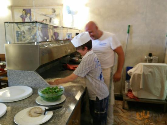 Pizza chef helping my son to make his own pizza!